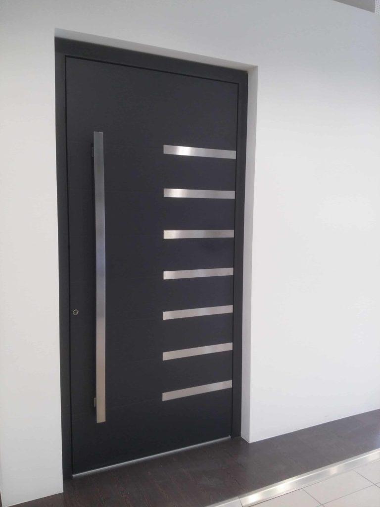 grey Dutemann Haus front doors