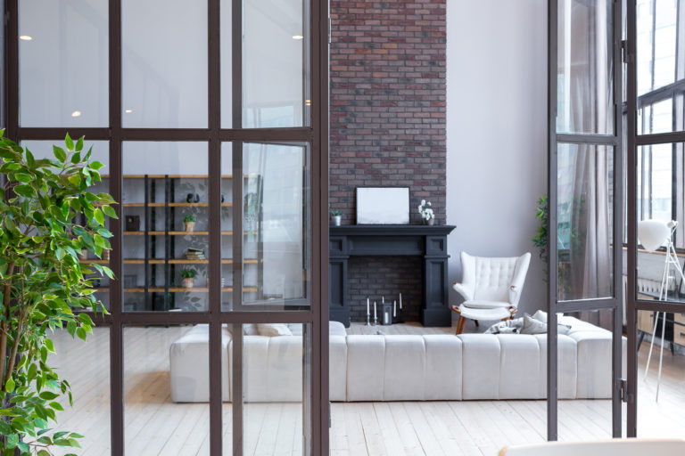 steel look screens separating a kitchen and lounge