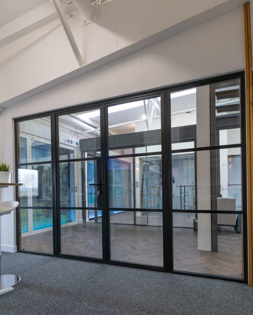 aluco steel look steel replacement screens in a kent showroom