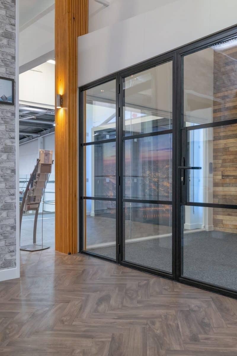 aluco doors and screen in a showroom