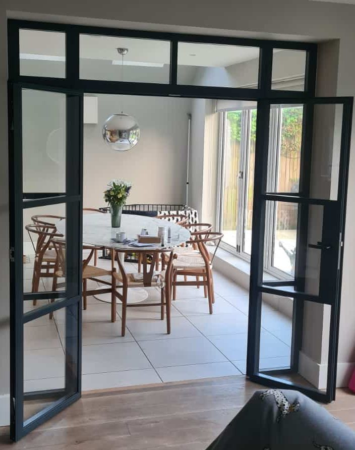steel-look interior doors in London dividing two rooms